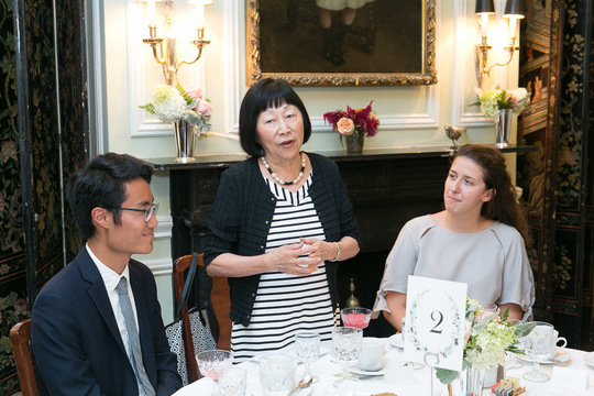 Ambassador Julia Chang Bloch speaking at an event with two young people at the table