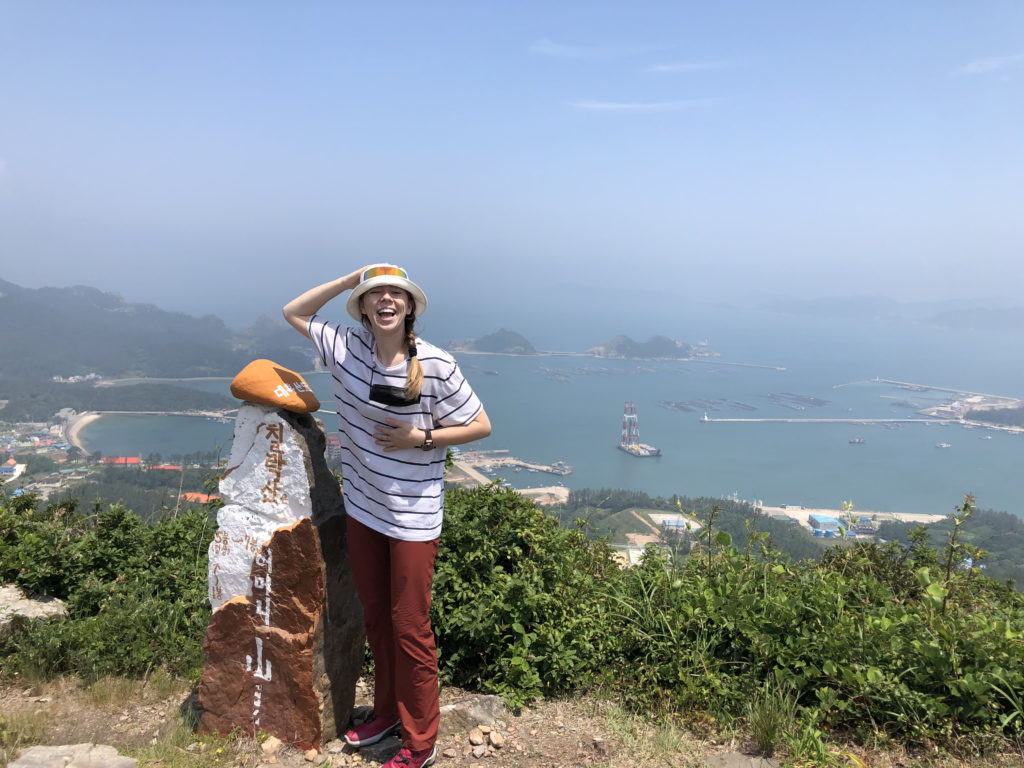 Fulbright grantee standing at top of mountain in South Korea